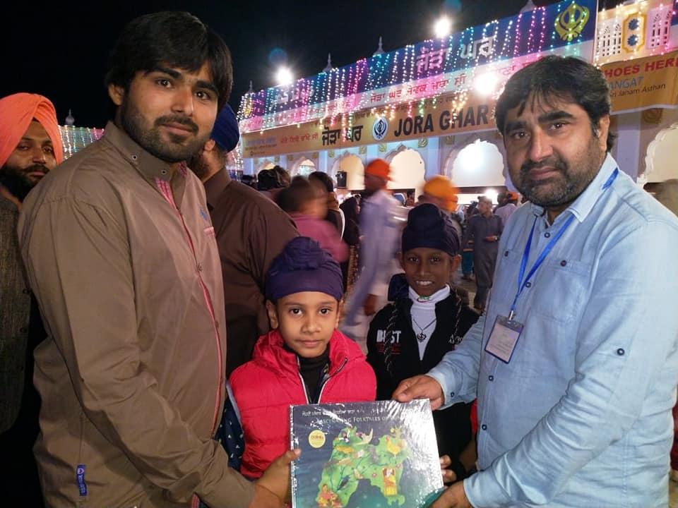 Children visiting Janam Asthan get a gift