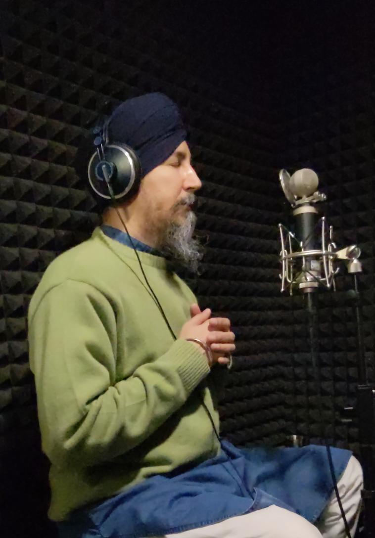 Manjit Singh recording a sabad