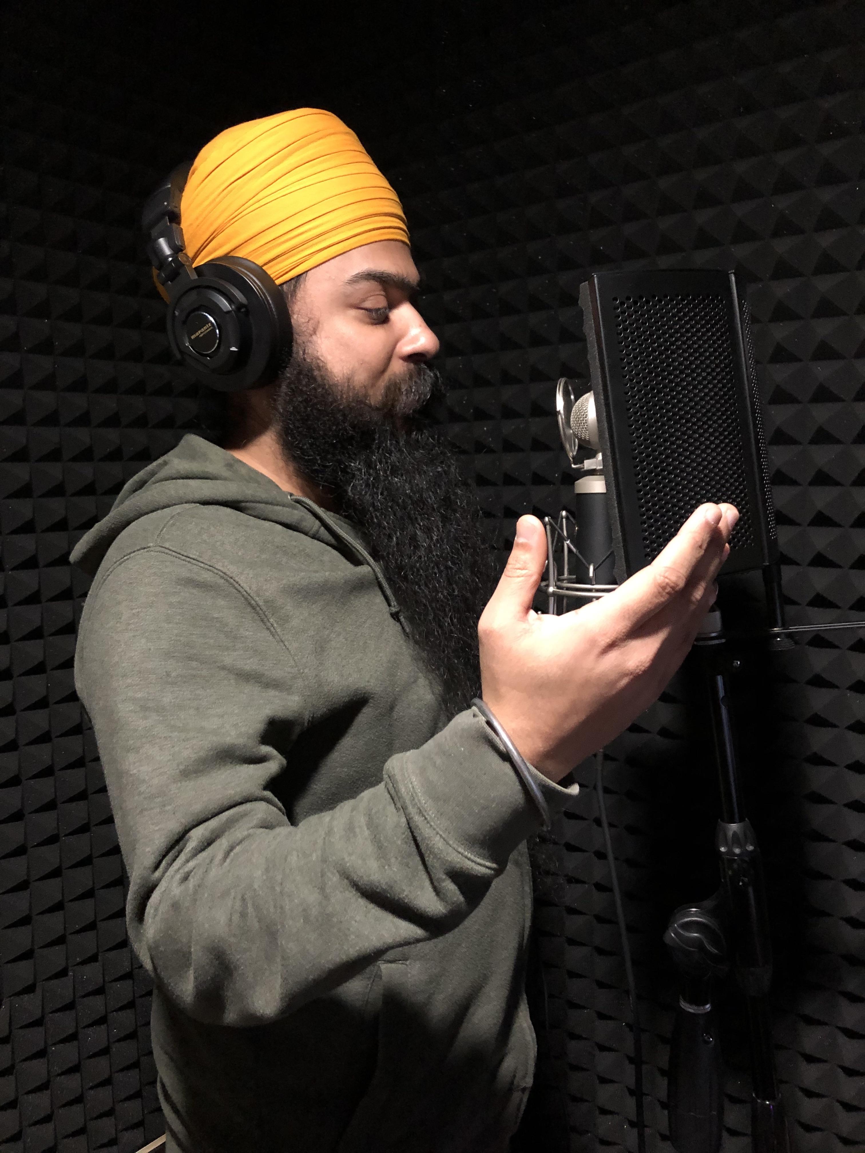 Prabhmeet Singh recording a sabad